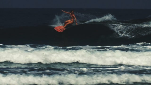 Alena surfing her twin fin fish in Mexico