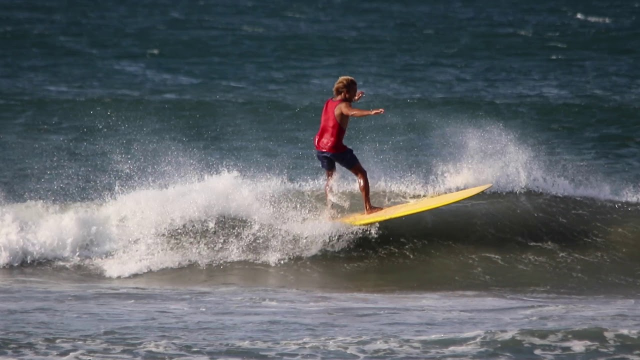 Surfing Playa Guiones on a small and windy day