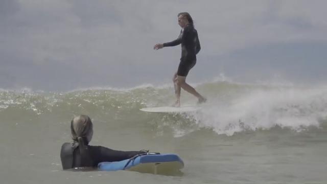Dylan Swindale surfing.
