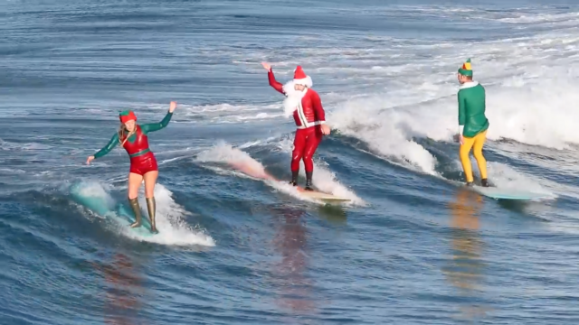 Santa and his elves take a much needed break to go surfing