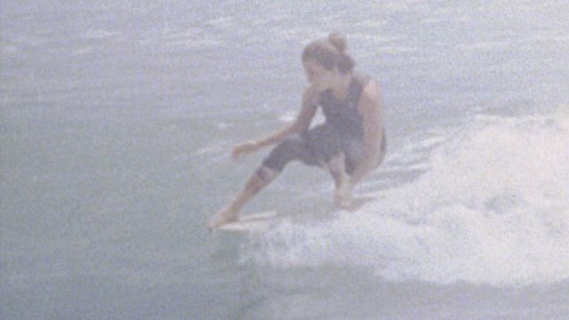 Kassia Meador and Lola Mignot surfing at Malibu